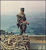 Marine Corps Officer, Kenneth Johnson, on OP on Hill 950 overlooking Khe Sanh, Note battery bag protecting pistol, 'American Indian Warior Today'